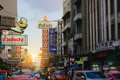 Bright signs of the stores, restaurants and car on china town Yaowarat Road Royalty Free Stock Image