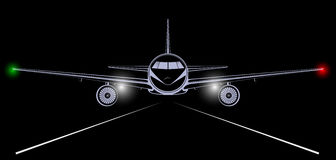 Bright silhouette of a jet airliner coming in to land in the night black sky. Royalty Free Stock Photo