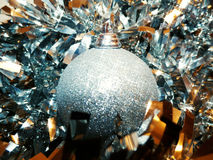 Bright Silver Bauble And Tinsel Royalty Free Stock Photography