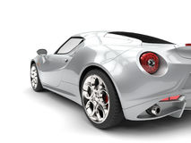 Bright silver luxury sports car - tail light closeup shot Royalty Free Stock Images