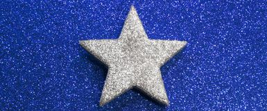 Bright silver star on golden background Stock Photography