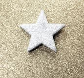 Bright silver star on golden shiny background Royalty Free Stock Images