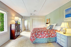 Bright simple bedroom with colofrul bed Stock Photos