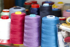 Bright skeins. Bright skeins of thread on a shelf sewing studio Stock Photography