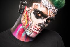 Bright skeleton makeup on mans face. Mystical face art concept, professiona face painting stock image