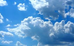 Bright skies, fluffy clouds Stock Photography