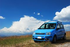 Bright sky blue modern car. Bright pale blue modern car with beautiful nature background Stock Photos