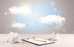 Bright sky with clouds and office desk Royalty Free Stock Photos