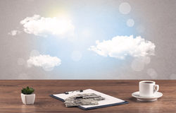 Bright sky with clouds and office desk Stock Image
