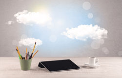 Bright sky with clouds and office desk Stock Images