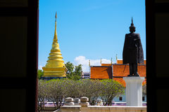 Bright sky with grass field in Nan Museum infront of golden pagoda Royalty Free Stock Images