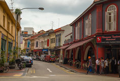 Bright and small buildings in asian street. Street in Little India quarter in Singapore Stock Photos