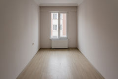 Bright Small Room of New Apartment with One Window Royalty Free Stock Photo