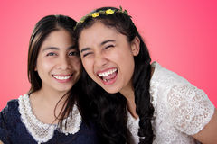 Bright smiling girls over pink background Royalty Free Stock Image