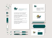 Bright snail. The bright corporate style with snail. Samples of business cards, a flash card, a pen, an envelope. Vector Stock Illustration