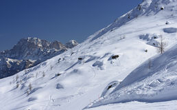 Snowy slope and Civetta peak, San Pellegrino pass Stock Photos