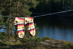 Bright socks drying after washing on the clotheline outdoors. Royalty Free Stock Photos
