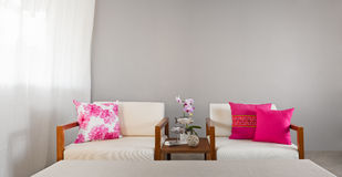 Bright sofa seat in grey bright setting Royalty Free Stock Photo