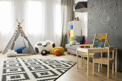 Bright and spacious child room idea Stock Images