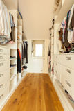 Bright spacious closet. View of bright spacious closet in modern house royalty free stock photography