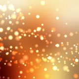 Bright sparkling bubbles of champagne in glass bottle or glass. Golden background creates a festive mood. Stock Images
