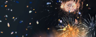 Bright sparkling multicolor fireworks and confetti panorama. Stars and lights pattern of bright sparkling colorful fireworks with motion textures and circle Stock Photo