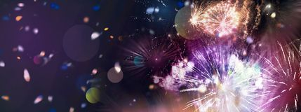 Bright sparkling multicolor fireworks and confetti panorama. Stars and lights pattern of bright sparkling colorful fireworks with motion textures and circle Stock Photos