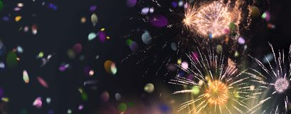 Bright sparkling multicolor fireworks and confetti panorama. Stars and lights pattern of bright sparkling colorful fireworks with motion textures and circle Royalty Free Stock Photo
