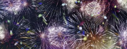 Bright sparkling multicolor fireworks and confetti panorama. Stars and lights pattern of bright sparkling colorful fireworks with motion textures and circle stock photography