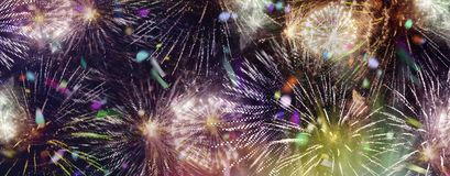 Bright sparkling multicolor fireworks and confetti panorama. Stars and lights pattern of bright sparkling colorful fireworks with motion textures and circle royalty free stock photos