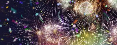 Bright sparkling multicolor fireworks and confetti panorama. Stars and lights pattern of bright sparkling colorful fireworks with motion textures and circle stock images