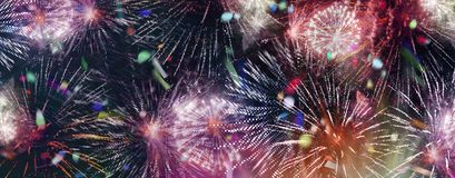 Bright sparkling multicolor fireworks and confetti panorama. Stars and lights pattern of bright sparkling colorful fireworks with motion textures and circle royalty free stock image