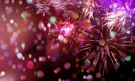 Bright sparkling multicolor fireworks and confetti. Stars and lights pattern of bright sparkling colorful fireworks with colorful stars, confetti and circle Stock Photos