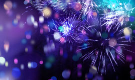 Bright sparkling multicolor fireworks and confetti. Stars and lights pattern of bright sparkling colorful fireworks with colorful stars, confetti and circle Royalty Free Stock Photo