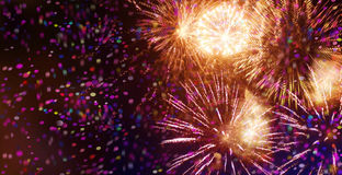 Bright sparkling multicolor fireworks and confetti Royalty Free Stock Images
