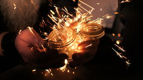 Sparks in a smithy. Bright sparks in a dark smithy close up stock video