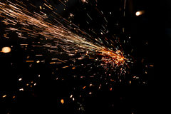 Bright sparks of metal. Against dark background Stock Images