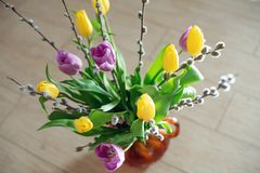 Free Bright Spring Bouquet Of Yellow And Purple Tulips And Branches Pussy Willows. Easter Arrangement Of Fresh Flowers Stock Photo - 143899660