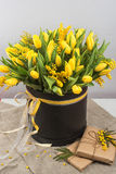 Bright spring bouquet of tulips and mimosa flowers Stock Image