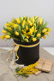Bright spring bouquet of tulips and mimosa flowers Royalty Free Stock Photo