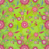 Bright spring seamless pattern with flowers and leaves. Royalty Free Stock Image