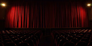 Bright stage. Long exposure theater stage, with empty audience seats Royalty Free Stock Images