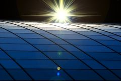 Bright Star. A bright star over the solar panel Royalty Free Stock Photo