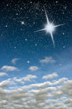 Bright star in blue sky Stock Photos
