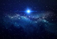 Bright star in outer space. Bright blue star shining in deep space, stellar explosion behind star clusters. High resolution galaxy background royalty free stock image