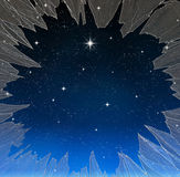 Bright star through smashed window. A single bright wishing star stands out from all the rest through a smashed window Royalty Free Stock Photo