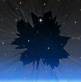 Bright star through smashed window. A single bright wishing star stands out from all the rest through a smashed window Stock Image