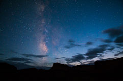 Bright Starry night with a Milky Way over the canyon Royalty Free Stock Photo