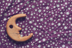 Bright stars and smiling wooden moon Stock Photo
