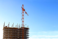 Bright stationary hoist and building under construction Stock Photography